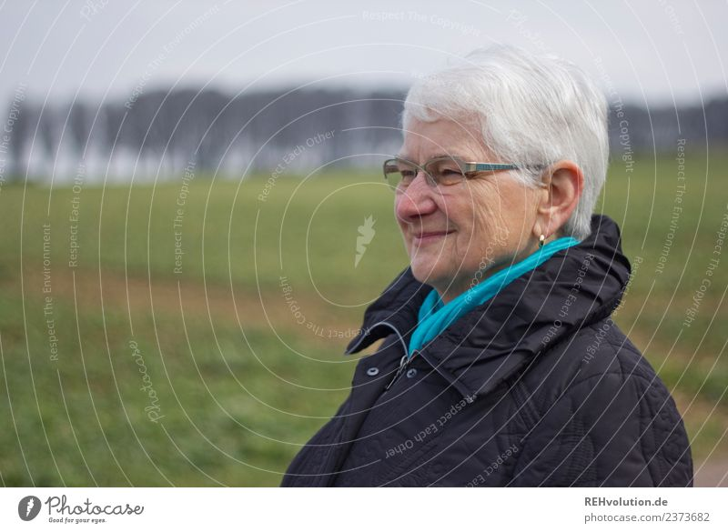 Senior smiles Human being Feminine Female senior Woman Grandmother Senior citizen Face 1 60 years and older Environment Nature Landscape Meadow Field Jacket