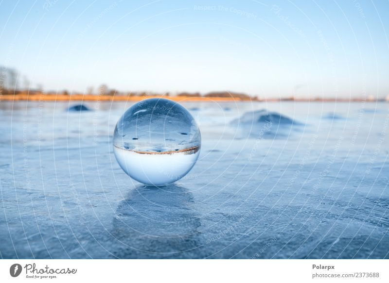 Transparent glass orb on a frozen lake Design Beautiful Wellness Meditation Winter Snow Mountain Decoration Nature Landscape Sky Tree Rock Lake Globe Glittering