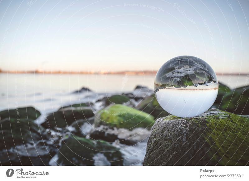 Glass orb on rocks by the sea covered Nature Plant Ocean Environment Coast Earth Lake Rock Bright Glittering Future River Clean Symbols and metaphors Meditation