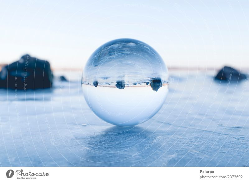 Glass orb balancing on ice on a frozen lake Design Beautiful Wellness Meditation Winter Snow Mountain Decoration Nature Landscape Sky Tree Rock Lake Globe