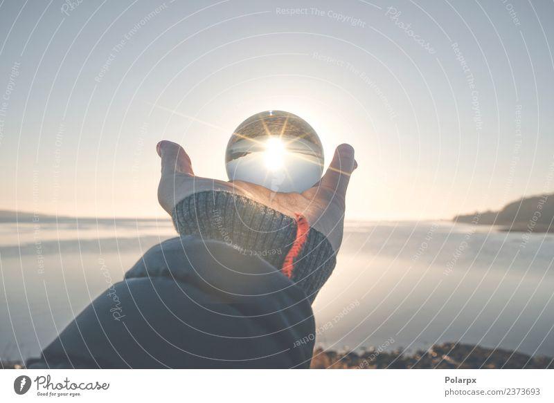Hand holding a crystal ball in the winter sunrise Nature Beautiful Landscape Sun Winter Life Autumn Natural Coast Lake Horizon Weather Glittering Vantage point
