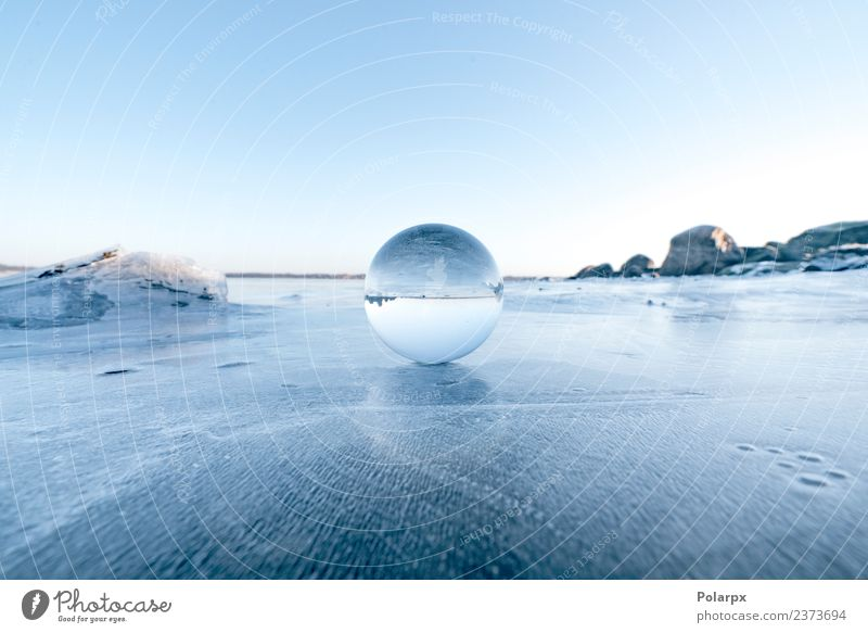 Elegant glass orb on ice on a frozen lake Design Beautiful Wellness Meditation Winter Snow Mountain Decoration Nature Landscape Sky Tree Rock Lake Globe
