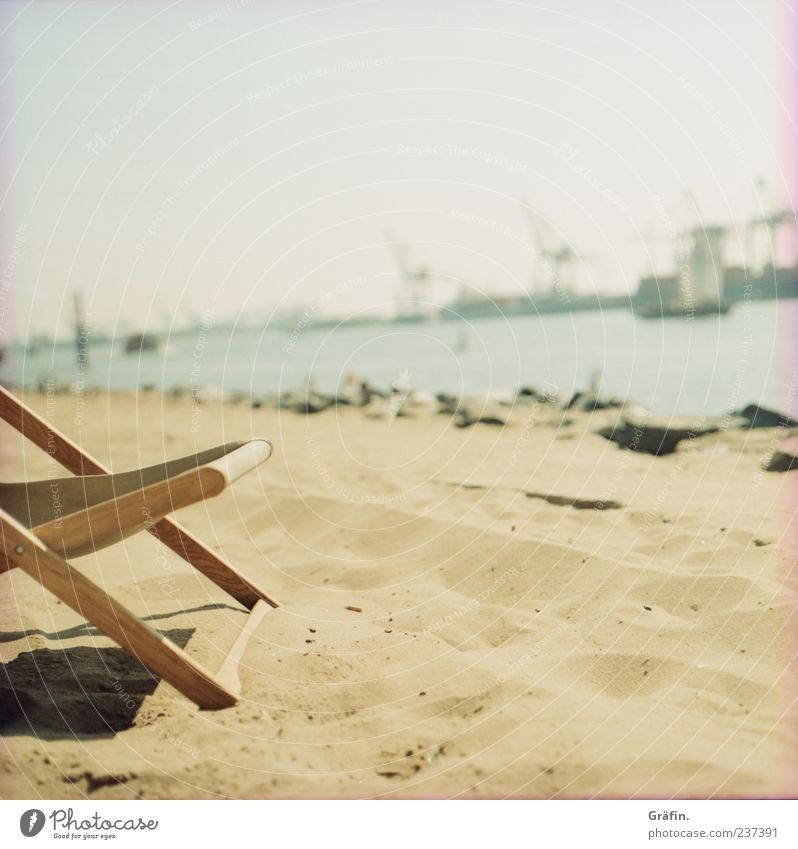 a day at the beach Relaxation Summer Sunbathing Beach Chair Industry Sand Warmth Harbour To enjoy Yellow Calm Loneliness Indifferent Comfortable Elbe Deckchair