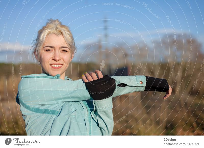 A beautiful young blonde woman stretching in a park Lifestyle Happy Beautiful Body Sports Track and Field Sportsperson Jogging Human being Feminine Young woman