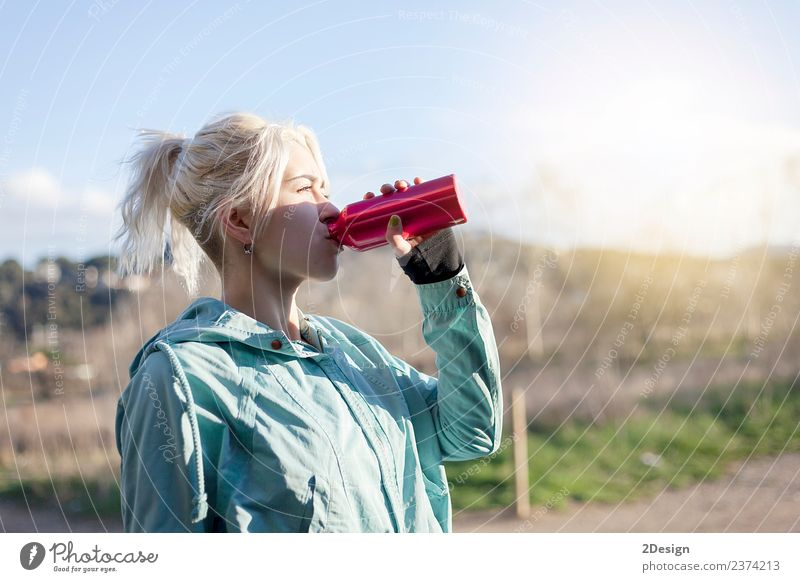 Blonde girl drinking water during morning jogging Bottle Lifestyle Beautiful Summer Sports Track and Field Sportsperson Jogging Human being Feminine Young woman