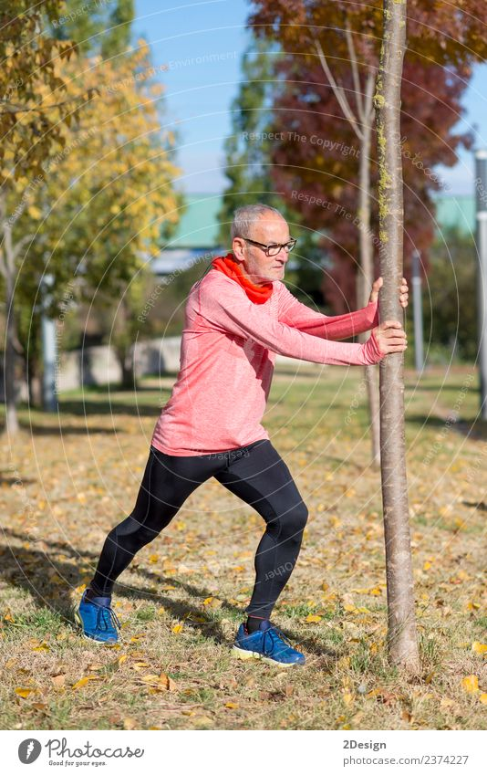 Senior Man Exercising In Park Diet Lifestyle Body Healthy Athletic Fitness Leisure and hobbies Summer Sports Jogging Human being Masculine Adults Male senior