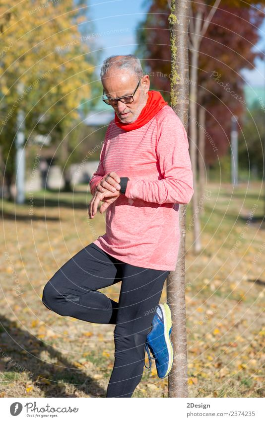 Portrait of a senior man using a smart watch. Lifestyle Wellness Relaxation Sports Jogging Work and employment Screen Technology Human being Feminine Man Adults