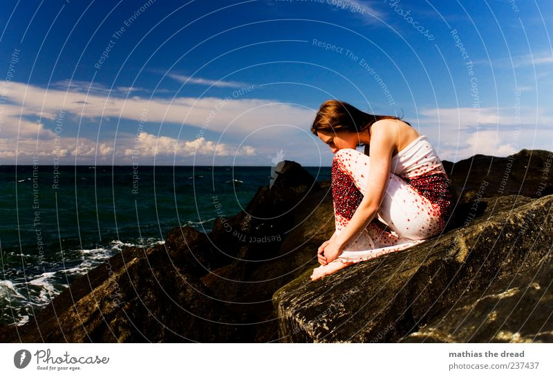 Sky Youth (Young adults) Water Beautiful Summer Clouds Loneliness Calm Adults Far-off places Feminine Emotions Coast Stone Sadness Style