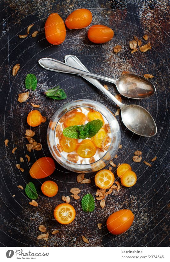 Chia pudding parfait, layered with kumquat and granola Yoghurt Fruit Dessert Eating Breakfast Diet Bowl Spoon Dark Bright Green White Colour Cereal chia Pudding