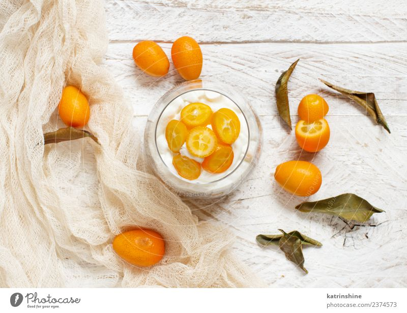 Chia pudding parfait, layered with kumquat and granola Yoghurt Fruit Dessert Eating Breakfast Diet Bowl Spoon Bright Green White Colour Cereal chia Pudding seed