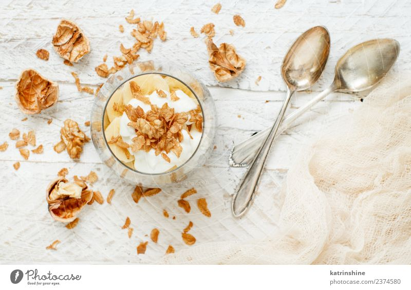 Chia pudding parfait, layered with banana and granola Yoghurt Fruit Dessert Eating Breakfast Diet Bowl Spoon White Cereal chia Pudding seed Dairy glass Gourmet