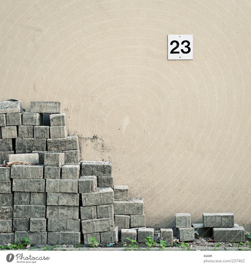 stoning Construction site Career Unemployment Wall (barrier) Wall (building) Stone Digits and numbers Signs and labeling Gloomy Corner 23 Material Stack