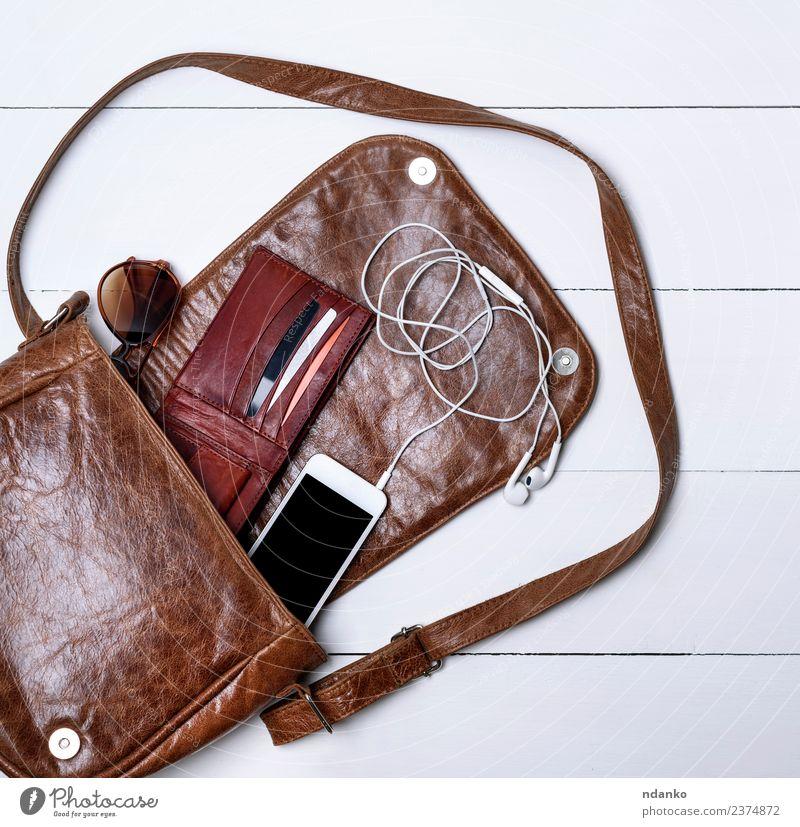 open female brown leather bag Elegant Style Design PDA Screen Fashion Leather Accessory Sunglasses Modern Brown Black White Colour Headphones device cord purse