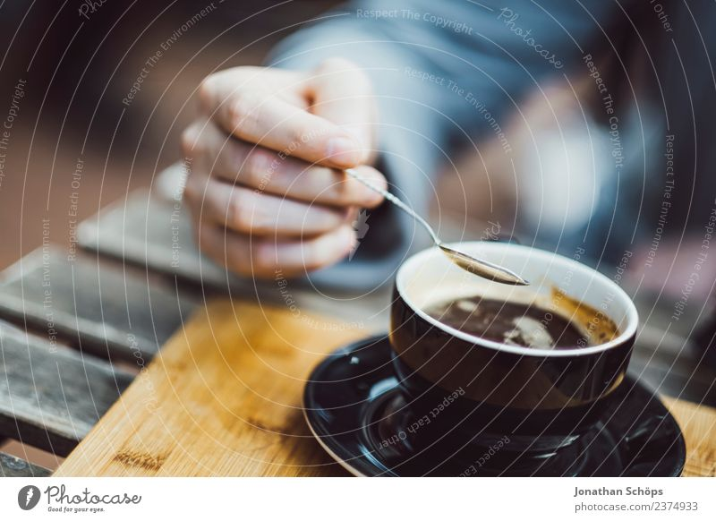 Man stirs with spoon in coffee Breakfast Beverage Drinking Hot drink Coffee Cup Spoon Lifestyle Style Restaurant Going out Human being Masculine Hand Fingers 1