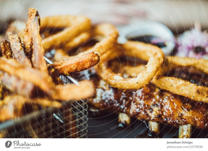 Ribs with onion rings and chips Food Meat French fries Onion ring rib Nutrition Eating Lunch Dinner Buffet Brunch Fast food deep fryer Overweight Senses Diet