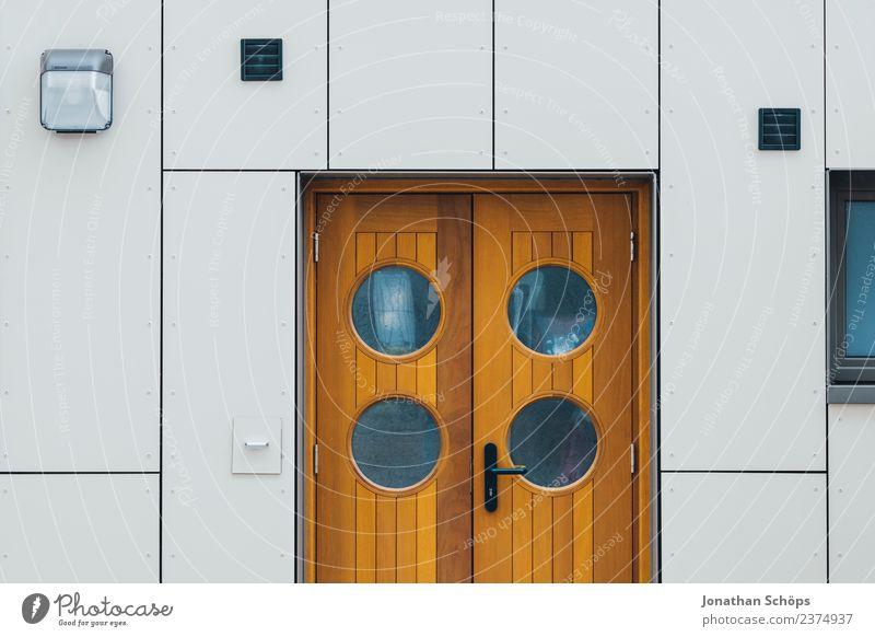 Door with round windows on white facade Wooden door front door outer door Round Peephole White Brown Modern Harbour Maritime Minimalistic geometric Architecture