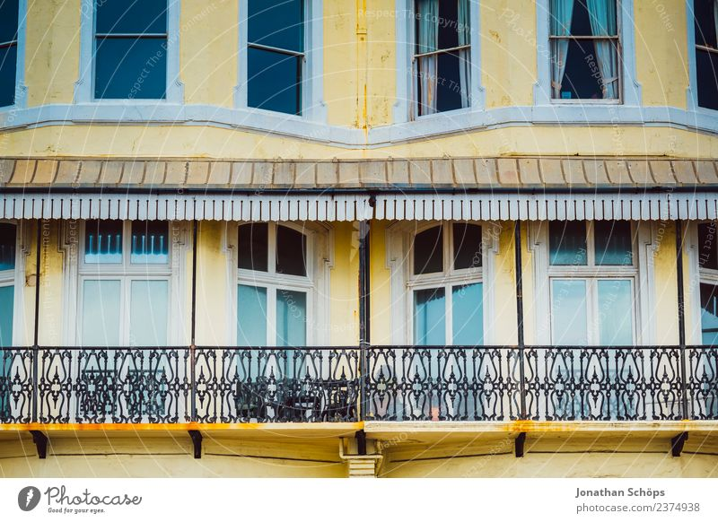 yellow facade with balcony in Brighton, England Town Downtown Populated House (Residential Structure) Building Architecture Facade Window Contentment Yellow