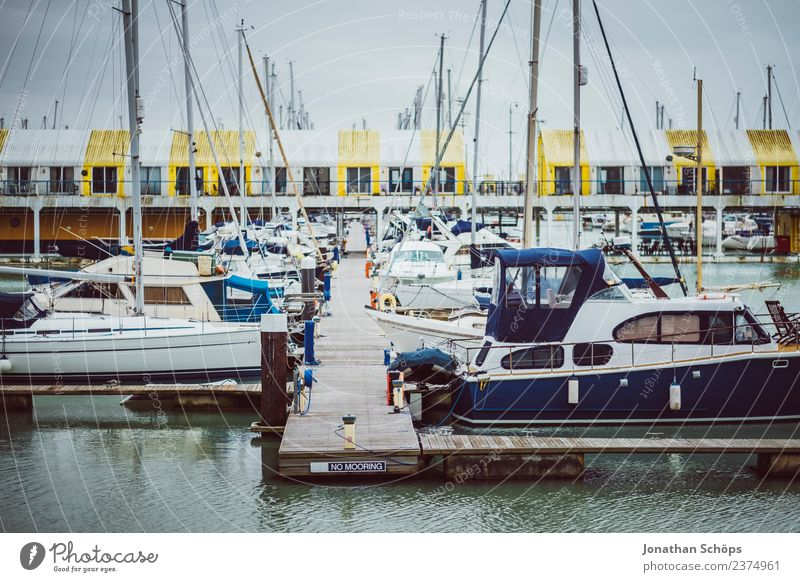 Boats at the harbour, Brighton Marina, England Town Port City Harbour Esthetic Rain Dreary Watercraft Footbridge Navigation Colour photo Exterior shot Deserted
