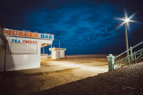 Kiosk at night at Brighton Beach, Brighton, England Esthetic Background picture Dark Light Night mood Night shot Structures and shapes Colour photo