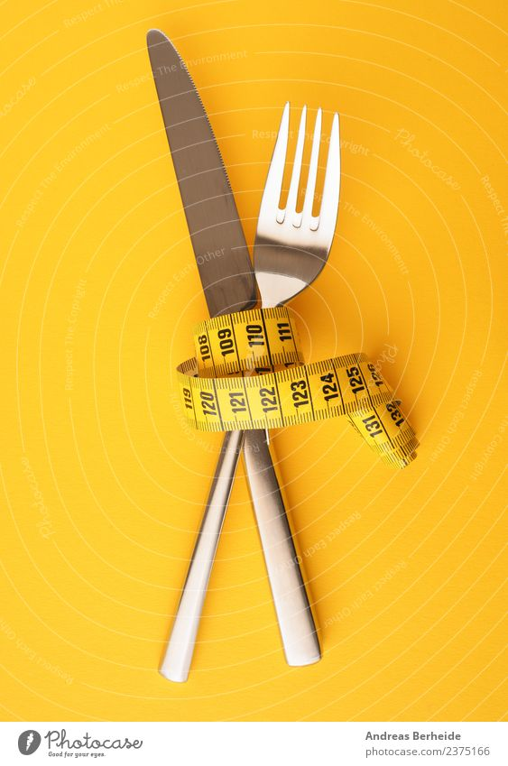 Knife and fork with a measuring tape Nutrition Diet Fasting Cutlery Knives Fork Lifestyle Healthy Healthy Eating Overweight Christmas & Advent Fitness To enjoy