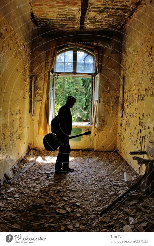 Man with guitar Masculine 1 Human being Artist Subculture Rockabilly Singer Musician Guitar Germany Europe Old town House (Residential Structure) Ruin