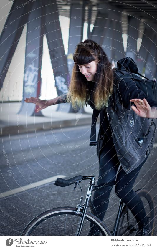 Young woman on a bicycle Youth (Young adults) Woman Bicycle Tattoo Hair and hairstyles Street Hamburg Bangs Driving Authentic Smiling Happy