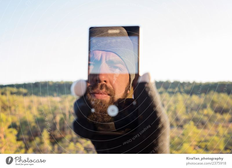 Bearded man taking selfie Lifestyle Face Leisure and hobbies Vacation & Travel Tourism Telephone PDA Screen Camera Man Adults Hand Nature Autumn Forest Smiling