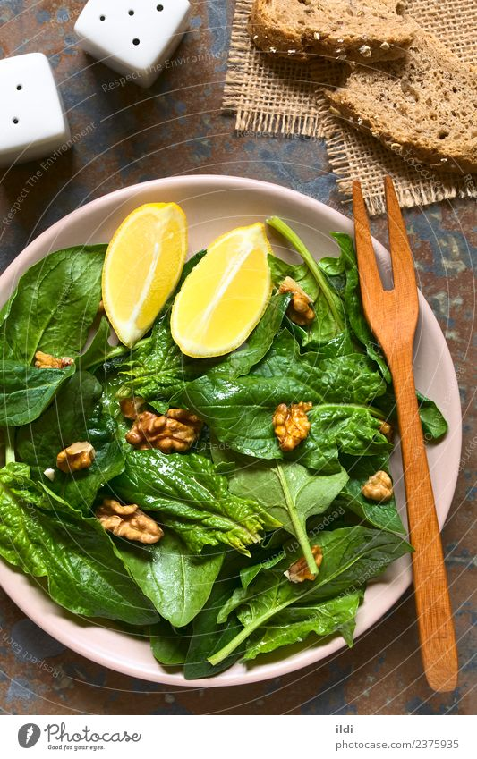 Spinach and Walnut Salad Vegetable Nutrition Vegetarian diet Diet Fresh Natural Green food walnut Raw Vegan diet healthy Dish Snack Lemon Wedge served Vertical