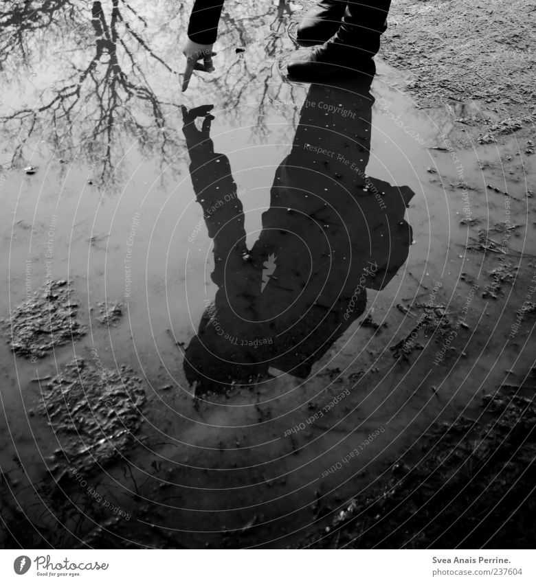 dive into the sky. 1 Human being Sky Bad weather Tree Boots Cold Thin Sadness Concern Grief Water Reflection Mirror image Shadow Dark Black & white photo