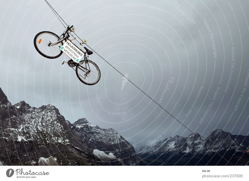 Summer Vacation & Travel Calm Clouds Mountain Gray Bicycle Rope Letters (alphabet) Alps Exceptional Part Symbols and metaphors Whimsical Bizarre