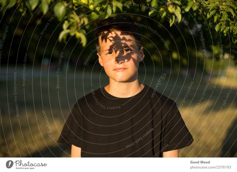 Portrait of young beautiful dreamy teen boy in garden Human being Nature Vacation & Travel Youth (Young adults) Man Summer Beautiful Green Sun Tree Leaf Forest