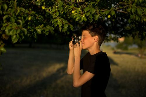 Young photographer with retro film photo camera in garden Style Beautiful Leisure and hobbies Vacation & Travel Summer Sun Garden Camera Technology Human being