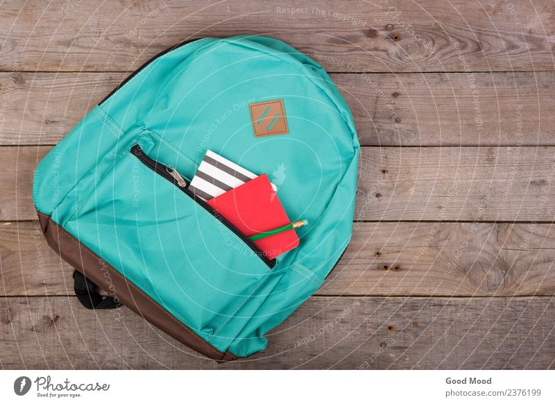 Backpack and school supplies: notepad, pencil on brown table Table Child School Academic studies Tool Wood Blue Brown bag notebook Pencil background education