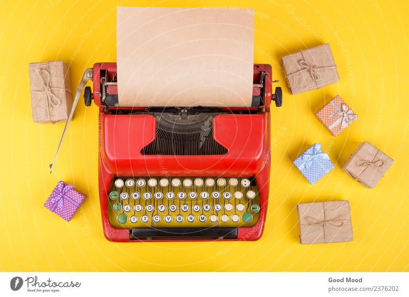 red typewriter with blank craft paper, gift boxes on yellow Old Christmas & Advent Red Adults Yellow Business Feasts & Celebrations Copy Space Retro Technology