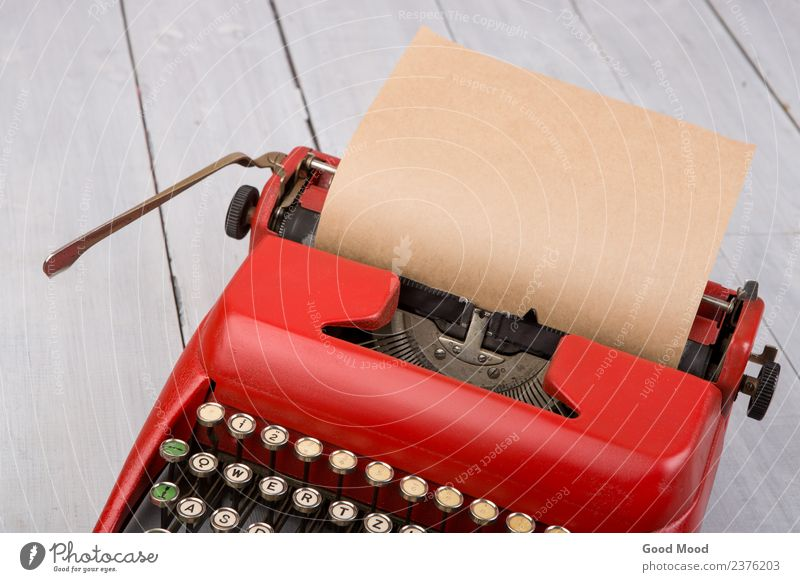 Red vintage typewriter with blank paper sheet on table Old White Wood Style Work and employment Office Retro Technology Table Paper Write Document Tracks