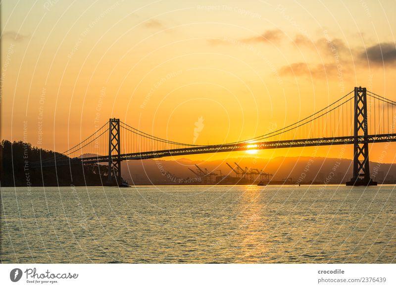 # 751 Oakland Bay Bridge San Francisco Harbour Ocean Sunrise Jetty Calm Back-light Colour photo Orange Light Suspension bridge Loneliness Crane