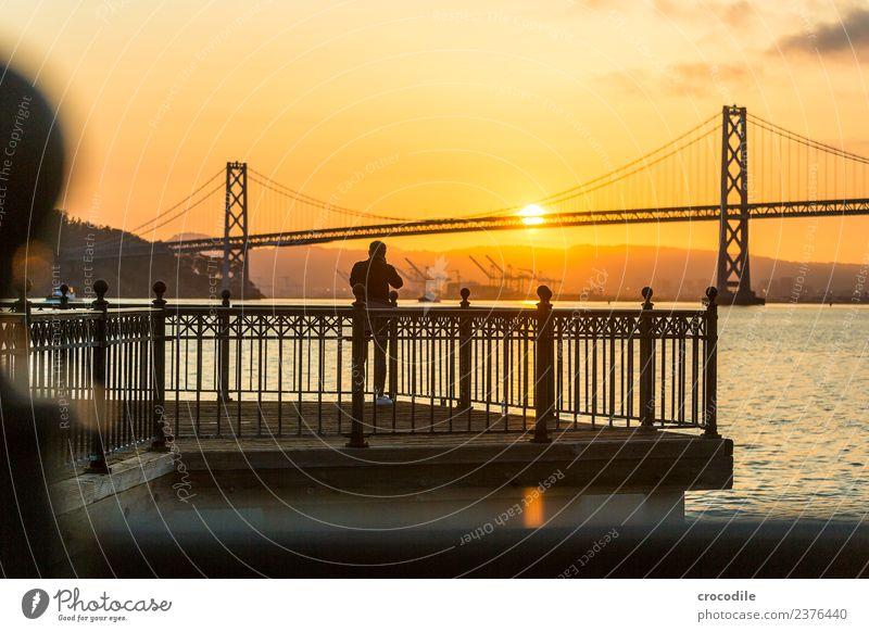 # 750 Oakland Bay Bridge San Francisco Harbour Ocean Sunrise Jetty Man Photographer Calm Back-light Colour photo Orange Light Suspension bridge Loneliness