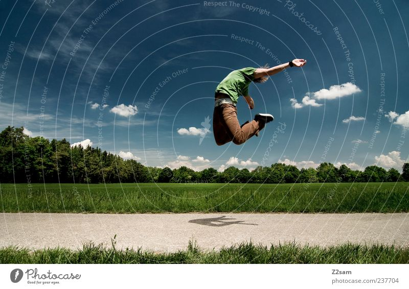 Human being Youth (Young adults) Sky Green Blue Summer Emotions Jump Style Movement Freedom Landscape Air Brown Adults Flying