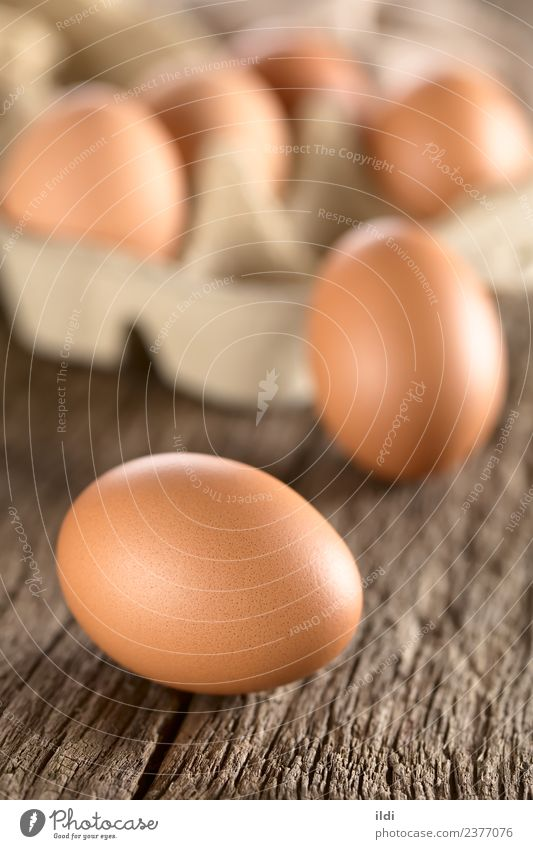 Raw Brown Eggs Nutrition Breakfast Easter Fresh food egg whole cooking Baking Protein Shell Eggshell wood Rustic Vertical raw ingredient dairy Colour photo