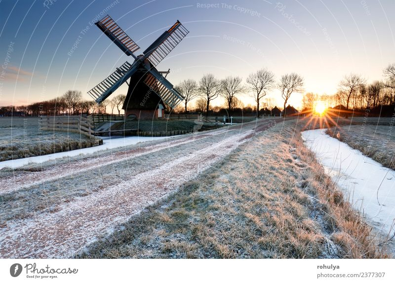 wintry sunrise over frozen countryside with windmill, Holland Winter Snow Landscape Sky Sunrise Sunset Weather Ice Frost River Building Architecture Street Blue