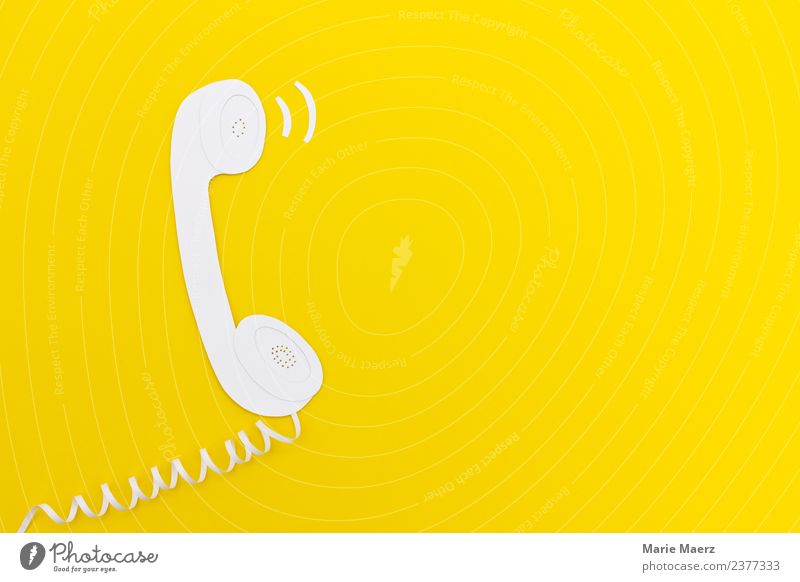 Paper ringing telephone Telecommunications Call center To talk Telephone Advice Communicate Esthetic Cool (slang) Yellow Virtuous Determination Friendliness