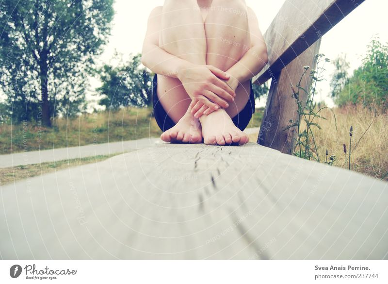 Lonely. Skin Arm Hand Fingers Legs Feet 1 Human being Bench Sit Uniqueness Natural Duck down Tree Meadow Colour photo Exterior shot Crouch Feminine Cross