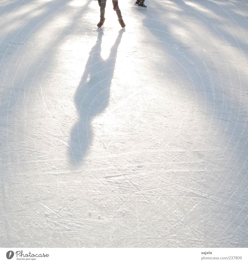 Human being White Winter Sports Ice Leisure and hobbies Esthetic Stand Sportsperson Winter sports Ice-skating Back-light Shadow play Silhouette Dark side