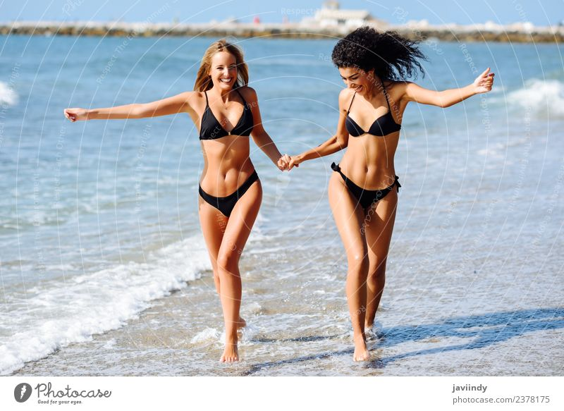 Two young women in bikini on a tropical beach. Lifestyle Joy Happy Beautiful Body Hair and hairstyles Leisure and hobbies Vacation & Travel Tourism Summer Beach