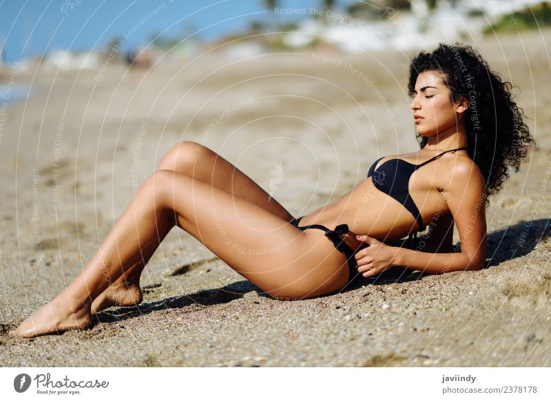 Woman with beautiful body in bikini on the beach sand. Lifestyle Happy Beautiful Body Hair and hairstyles Skin Leisure and hobbies Vacation & Travel Tourism