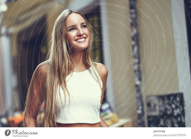 Young woman smiling in urban background. Woman Human being Youth (Young adults) Summer Beautiful White Joy 18 - 30 years Adults Street Lifestyle Autumn Feminine