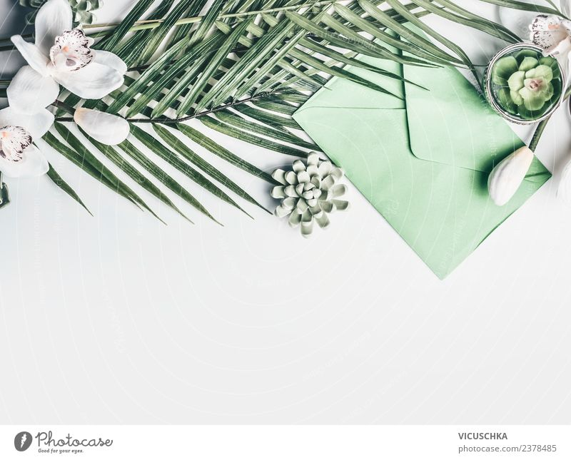 Green tropical leaves with flowers and envelope Style Design Vacation & Travel Summer Desk Event Feasts & Celebrations Wedding Birthday Flower Leaf Blossom