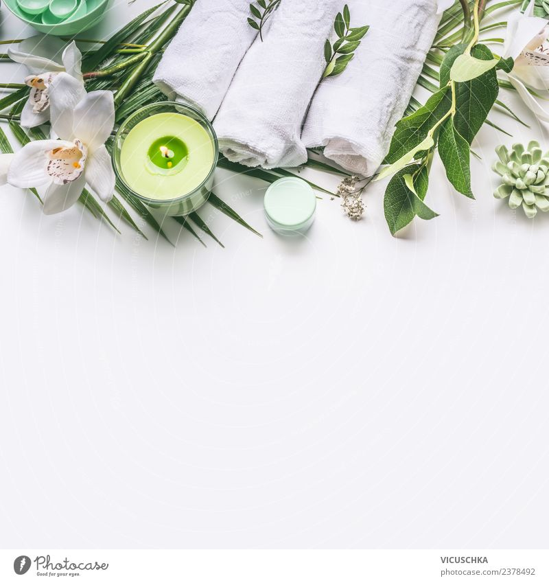 Green spa background with cloth, candle and orchid Style Design Beautiful Personal hygiene Cosmetics Cream Wellness Relaxation Spa Bathroom Plant Flower Orchid