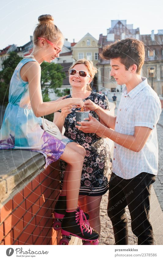 Family spending time together in the city centre Woman Human being Vacation & Travel Youth (Young adults) Man Young woman Summer Town Beautiful Young man