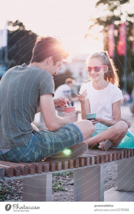 Young girl and boy spending time together in the city centre Woman Human being Vacation & Travel Youth (Young adults) Man Young woman Summer Town Young man Joy